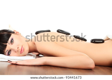 Beautiful woman relaxing in a spa salon. Isolated over white.