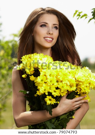 Beautiful woman relaxing in flower field