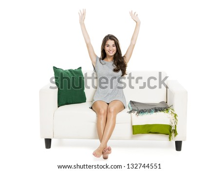 Beautiful woman relaxing on a sofa isolated over a white background