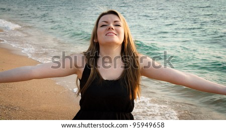 Beautiful woman relaxing on the beach - stock photo