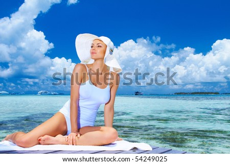 Beautiful woman resting near water at Maldives