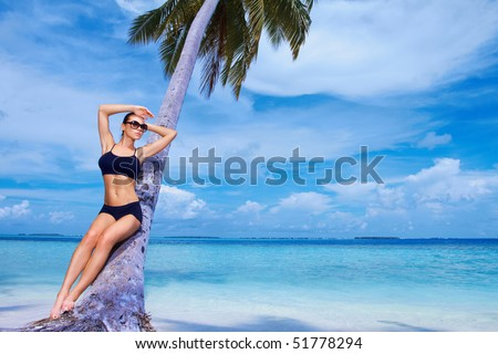 Beautiful woman resting on beach at Maldives