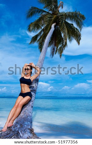 Beautiful woman resting on beach at Maldives - stock photo