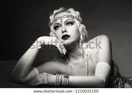 beautiful woman retro flapper style woman black and white foto, roaring 20s #1210035100