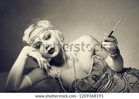 beautiful woman retro flapper style woman monochrome sepia, roaring 20s #1209368191