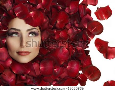Beautiful Woman's Face and rose petals.Perfect Skin - stock photo