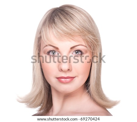 Beautiful woman's face with clean skin isolated