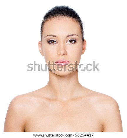 Beautiful woman's face with clean skin - isolated on white
