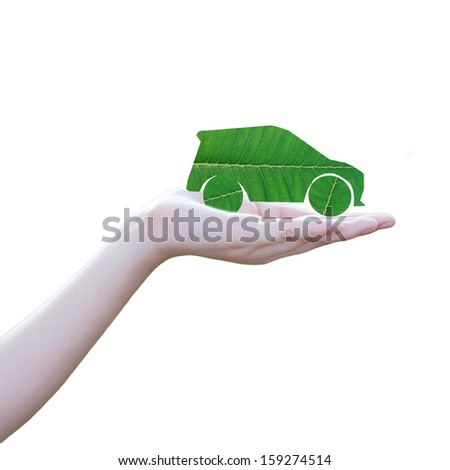 beautiful woman's hand, eco car cut from leaf on hand. Isolated