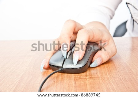 beautiful woman's hand holding a computer mouse, isolated over white