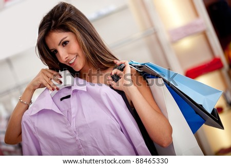 Beautiful woman shopping for clothes at a store