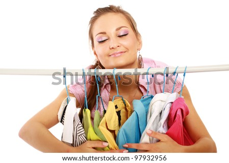 Beautiful woman shopping for some clothes at a store isolated on white background
