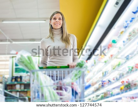 Beautiful woman shopping in a supermarket