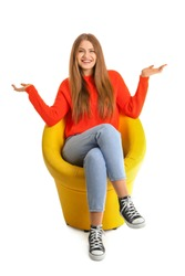 Beautiful woman sitting in armchair on white background