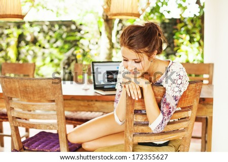 beautiful woman sitting near computer at home