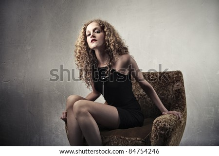 Beautiful woman sitting on an armchair