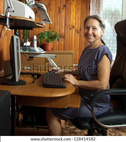 beautiful woman sitting on black chair of the computer