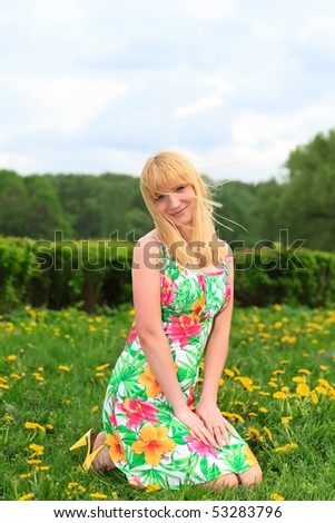 http://image.shutterstock.com/display_pic_with_logo/109564/109564,1274116704,2/stock-photo-beautiful-woman-sitting-outdoors-smiling-53283796.jpg