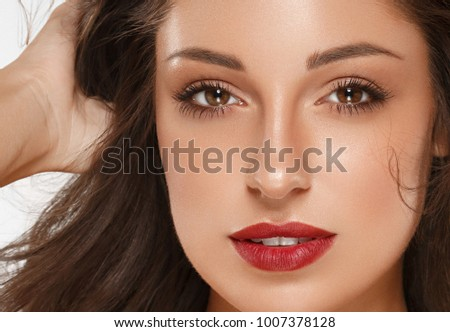 Beautiful Woman Skin Tanned Red Lips Healthy Beauty Skin Smile. Spa Beautiful Model Girl Cute Face over color background. #1007378128
