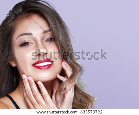 Beautiful Woman Skin Tanned Red Lips Healthy Beauty Skin Smile. Spa Beautiful Model Girl Cute Face over color background.