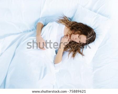 beautiful woman sleeping on the bed