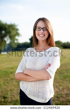 Beautiful woman smiling outdoors wearing glasses