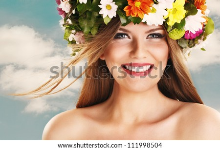 Beautiful woman smiling with flower wreath on head