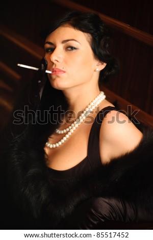 Beautiful woman smokes a cigarette.