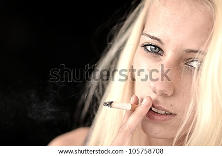 Beautiful woman smoking a cigarette stock photo 105758708