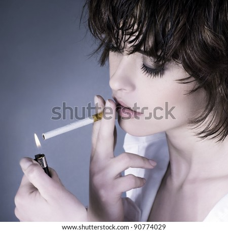 Beautiful woman smoking a cigarette