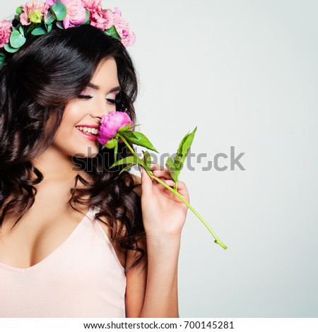 beautiful woman sniffing a...