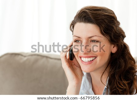 Beautiful woman speaking on the phone at home