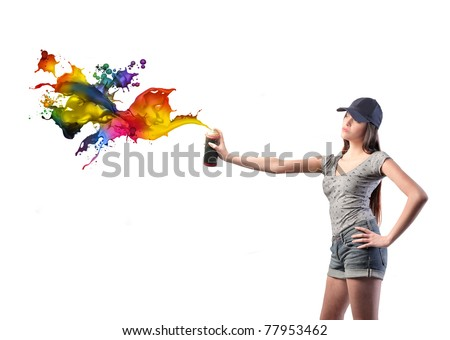 Beautiful woman spraying colored paint