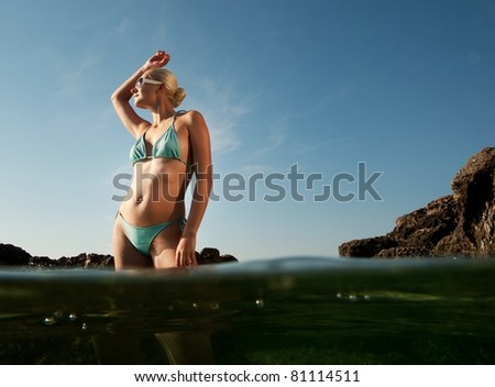 Beautiful woman standing in a water