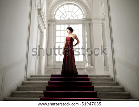 Beautiful woman standing on the top of a stairway