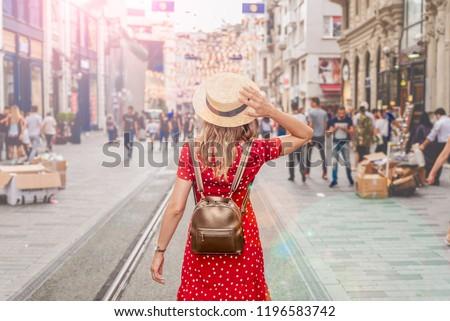 Beautiful woman stands at Istiklal street,a popular location in Beyoglu district,Istanbul,Turkey #1196583742