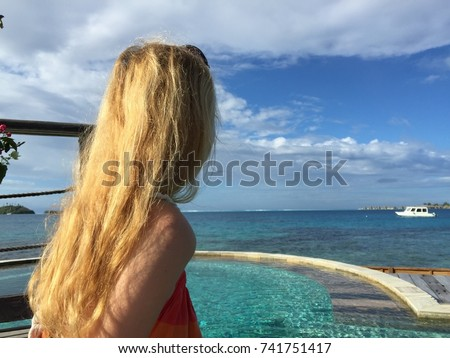 Beautiful Woman staring at the ocean. Gorgeous woman with blonde hair on beach enjoying summer holiday. tropical paradise. Caribbean sea. Relax concept. Tourism concept. Tourism travel. Tourist woman #741751417