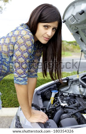 Beautiful woman stressed out for broken engine