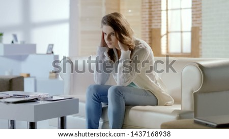Beautiful woman suffering headache, worrying about problems, migraine in pms