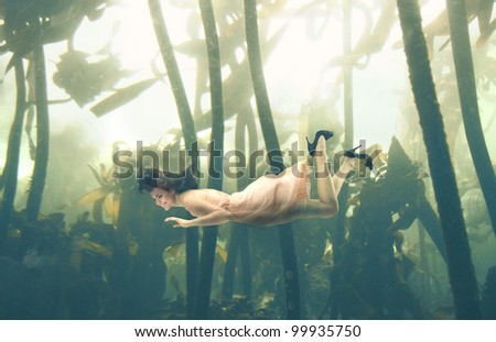 Beautiful woman swimming underwater