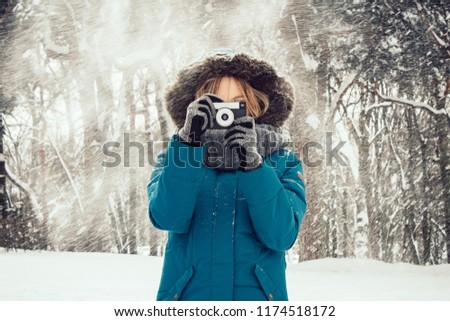 Beautiful woman taking picture outdoors