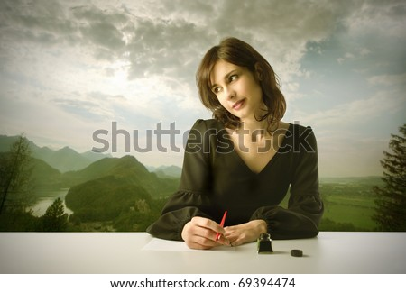 Beautiful woman thinking while writing with landscape on the background