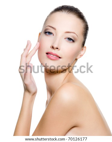Beautiful woman touching the cheek on face - on white background.