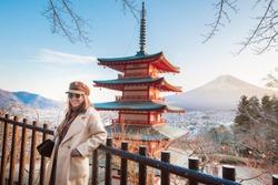 Beautiful woman Tourist smiling on Chureito pagoda and  Fuji mountain, Japan