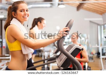 Beautiful woman training in a gym