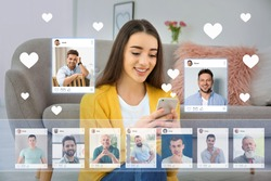 Beautiful woman visiting online dating site via smartphone indoors