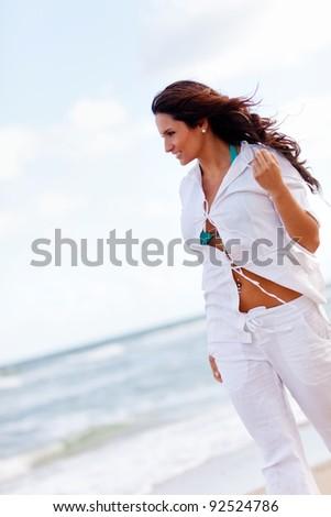 Beautiful woman walking at a peaceful beach