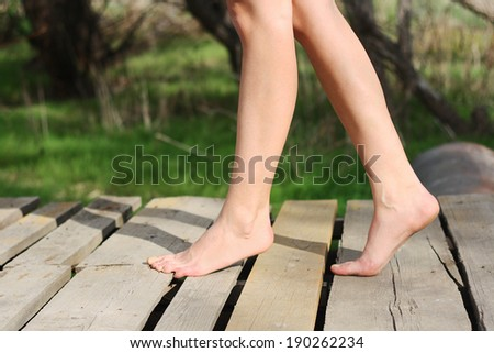 beautiful woman walking without shoes sunny day