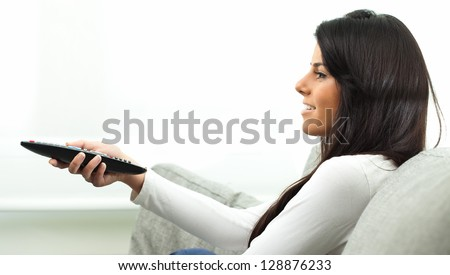 Beautiful Woman Watching Tv, Indoors - stock photo