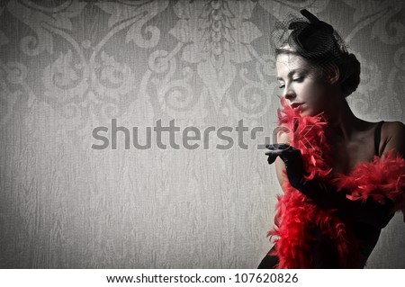 Beautiful woman wearing a red feather boa